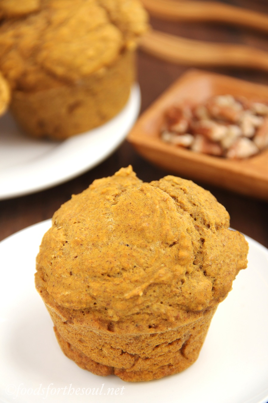 Spiced Pumpkin Muffins -- moist and healthy! Guaranteed to be your favorite fall treat. There's only 162 calories in each tall muffin! | by Foods for the Soul {foodsforthesoul.net}