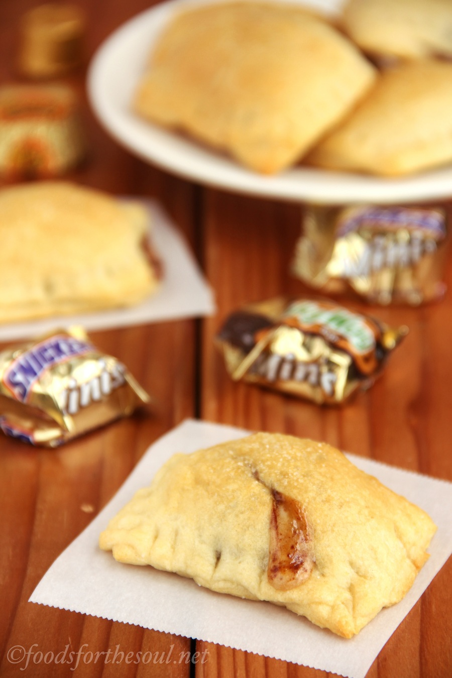 Mini Candy Bar Turnovers -- only 4 ingredients! Perfect for any extra Halloween candy. {Recipe at foodsforthesoul.net}