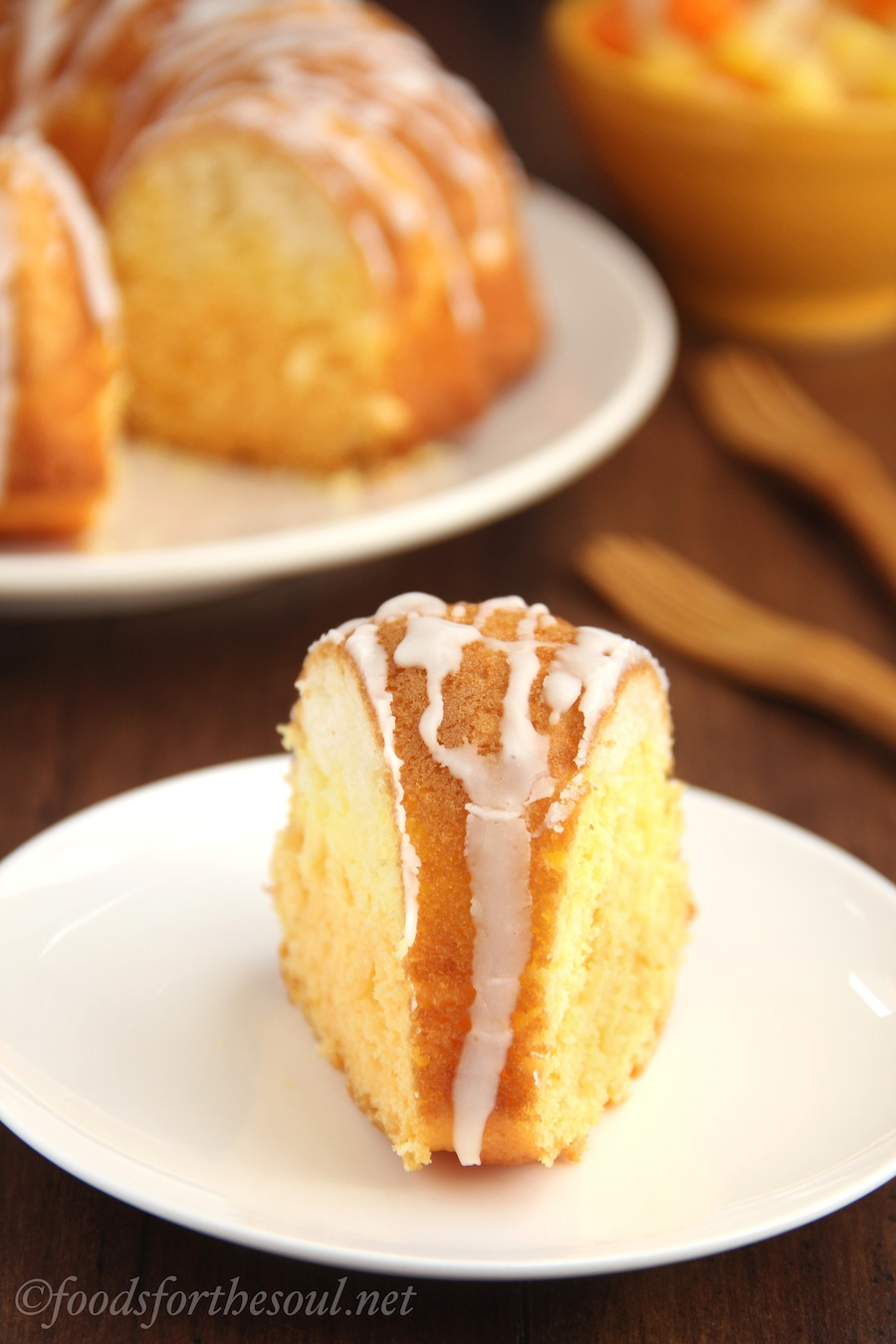 Citrus Candy Corn Bundt Cake -- white, lemon & orange cake batters layered and sliced to look like candy corn! SO cute for Halloween!