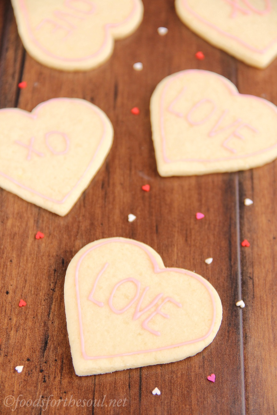 Skinny Heart-Shaped Sugar Cookies -- these don't taste healthy at all! They're SO buttery & super easy to make. You'll never need another recipe again!