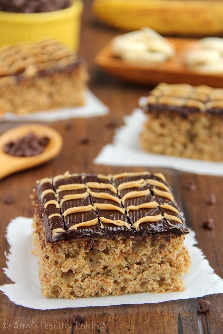 Banana Cake with Fudgy Chocolate Peanut Butter Swirl Frosting. Guilt-free & so moist! You NEED to try this frosting!