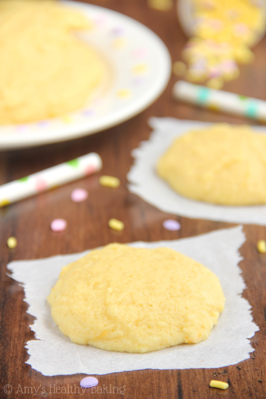 An easy no-mixer-required recipe for sweet lemon cookies! The softest & chewiest you'll ever eat -- under 100 calories each!