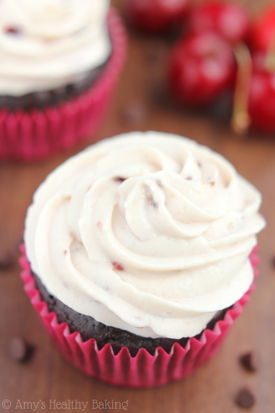 Chocolate Coke Cupcakes with Cherry Vanilla Frosting -- my new favorite dessert recipe! And they're only 150 calories each!