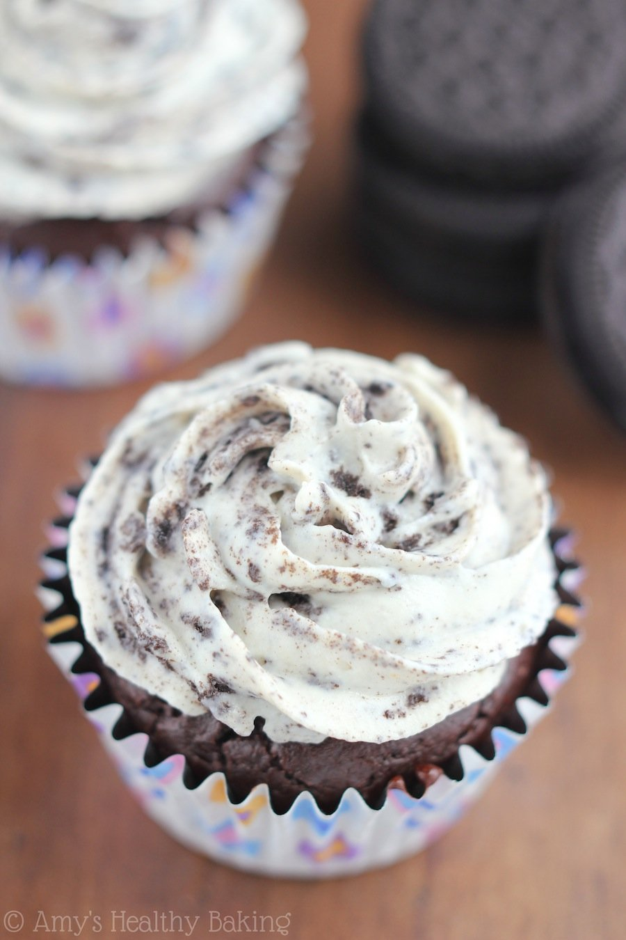 Dark Chocolate Cupcakes with the BEST Cookies 'n Cream Frosting recipe -- and it contains no butter or powdered sugar!