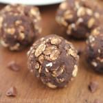 Dark Chocolate Blueberry Energy Bites -- like a cross between brownies & oatmeal cookies! Only 4 ingredients & 10+ grams of protein!