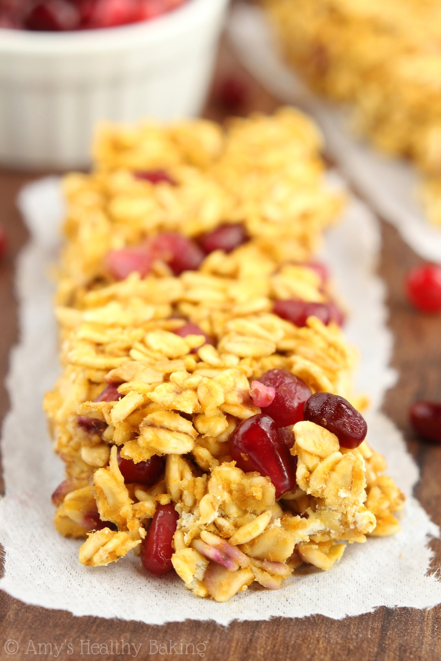 A simple recipe for skinny, clean-eating Pomegranate Pumpkin Granola Bars. So much healthier & cheaper than store-bought ones!
