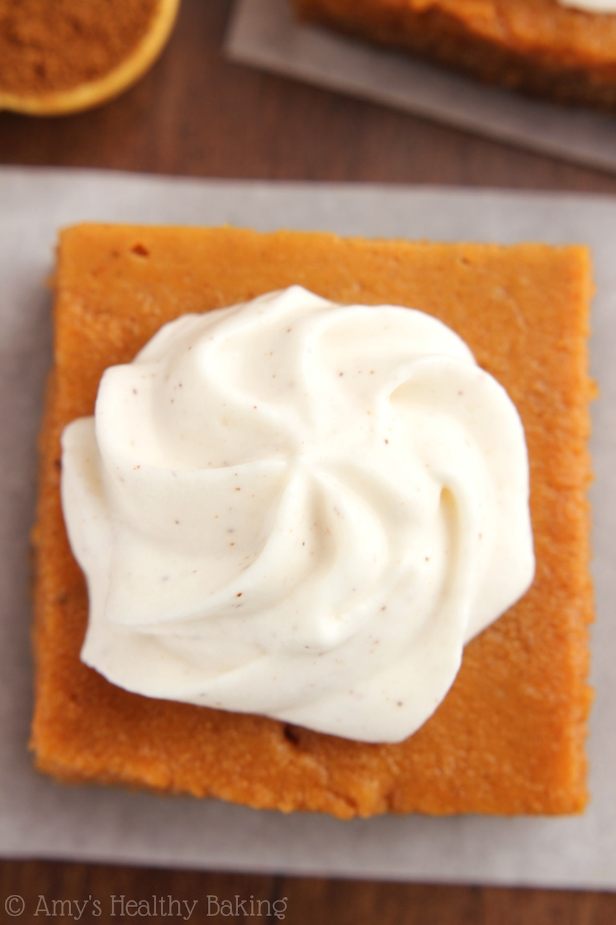 Pumpkin Pie Bars with Greek Yogurt Whipped Cream -- even better than pie & the whipped cream is amazing! No one can tell it's lightened up!!