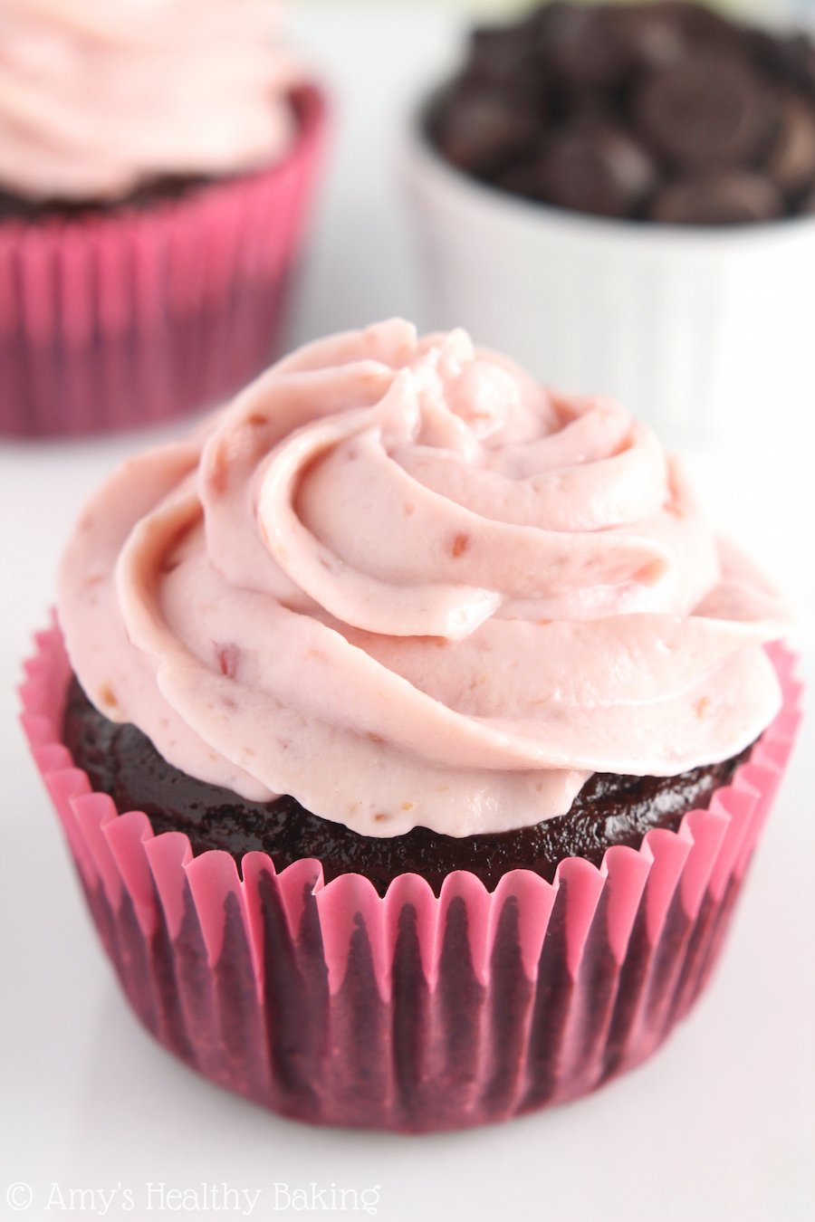 Dark Chocolate Cupcakes with Raspberry Frosting -- easy, healthy & decadent! That frosting is the BEST I've ever had! Smooth, creamy & NO butter or powdered sugar!