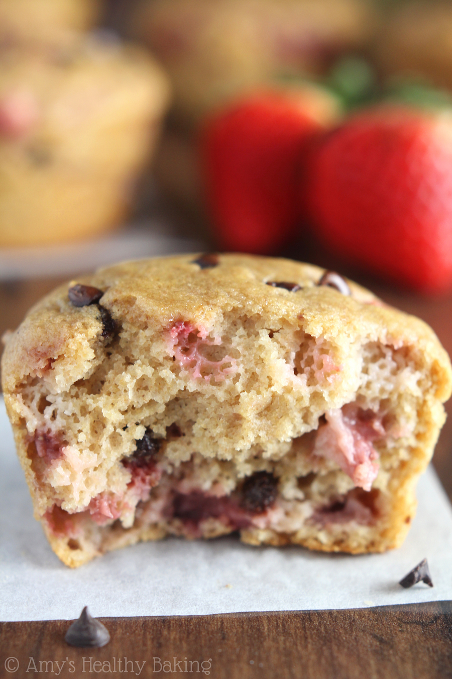Whole Wheat Strawberry Chocolate Chip Muffins -- SO much fruit & chocolate! These practically taste like cupcakes for breakfast!