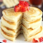 The Ultimate Healthy Buttermilk Pancakes -- so light & fluffy! These are WAY better than any pancakes I've ever had! They don't taste healthy at all!