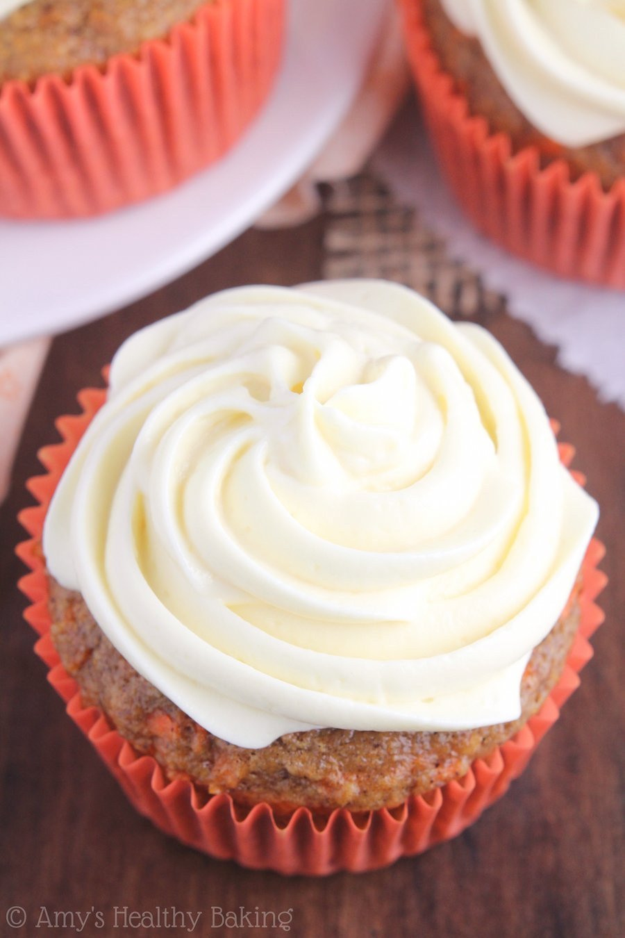 Classic Carrot Cake Cupcakes -- an easy, clean eating recipe topped with protein-packed cream cheese frosting! They're practically healthy enough for breakfast!