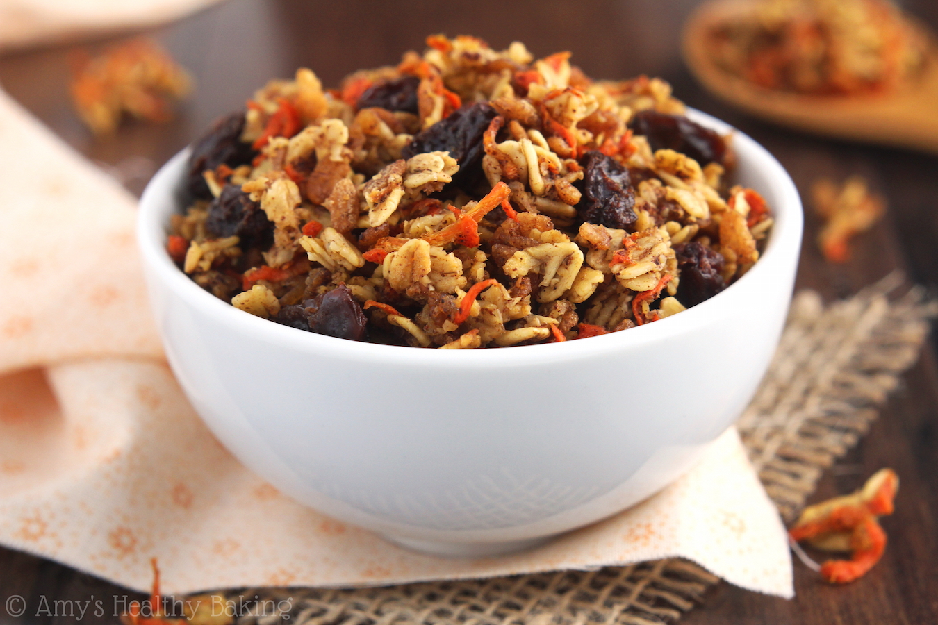 Clean-Eating Carrot Cake Granola -- a healthy, fuss-free recipe full of clusters that lets you eat dessert for breakfast!