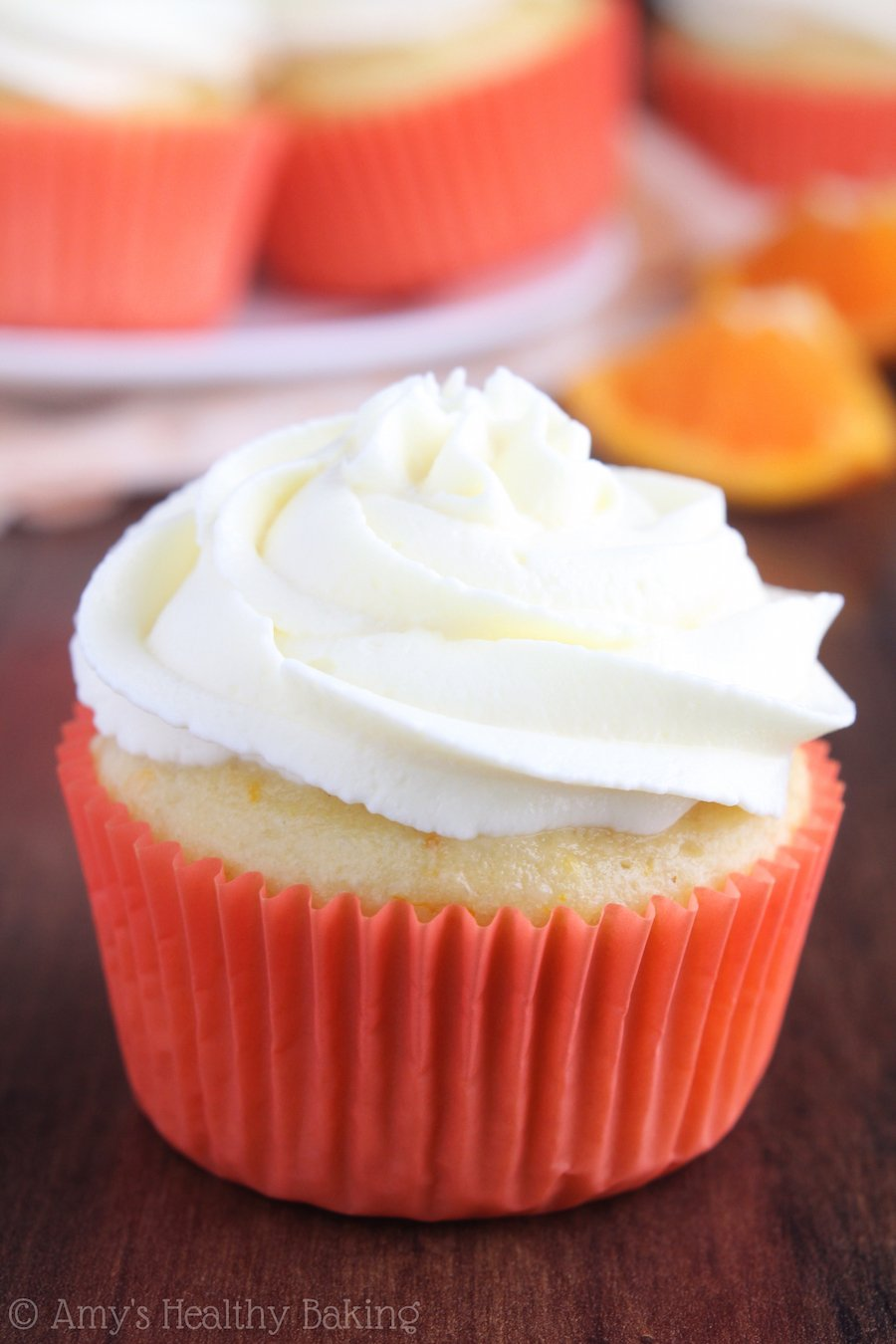 Skinny Orange Creamsicle Cupcakes -- a healthier dessert that still tastes like the popsicle! Barely 160 calories & the Greek yogurt frosting is phenomenal!