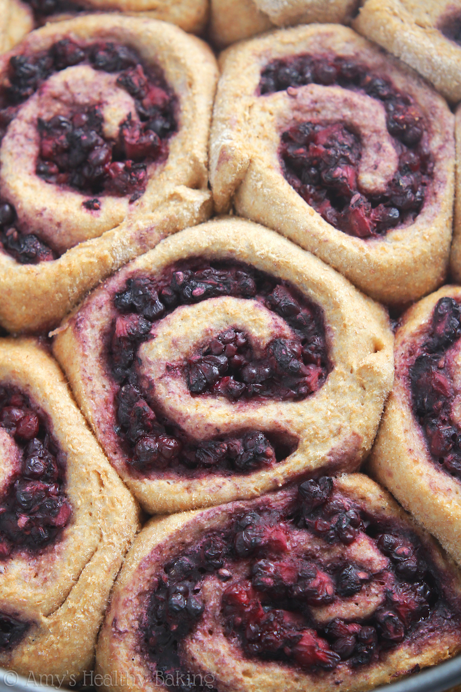 Clean-Eating Blackberry Almond Sticky Buns -- sweet, buttery, caramel bliss! These skinny pastries don't taste healthy at all!