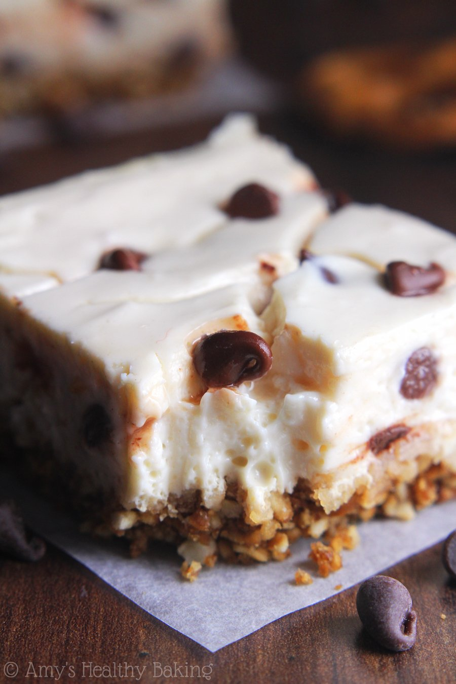 Skinny Chocolate Chip Pretzel Cheesecake Bars -- so easy to make & packed with protein! Barely 100 calories!