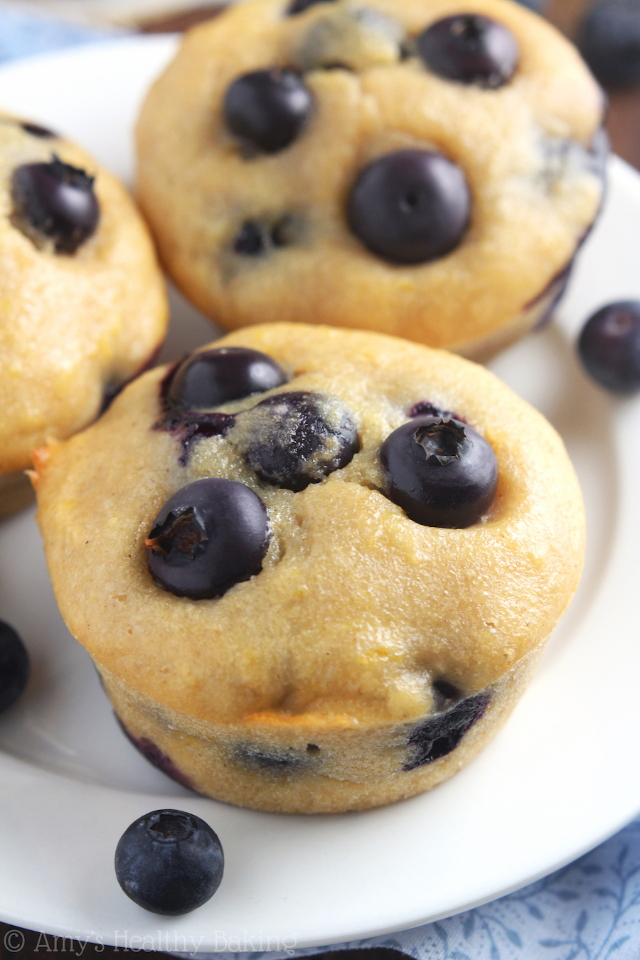 Small-Batch Lemon Blueberry Muffins -- an easy clean-eating recipe that practically tastes like cupcakes! These skinny muffins don't taste healthy at all!