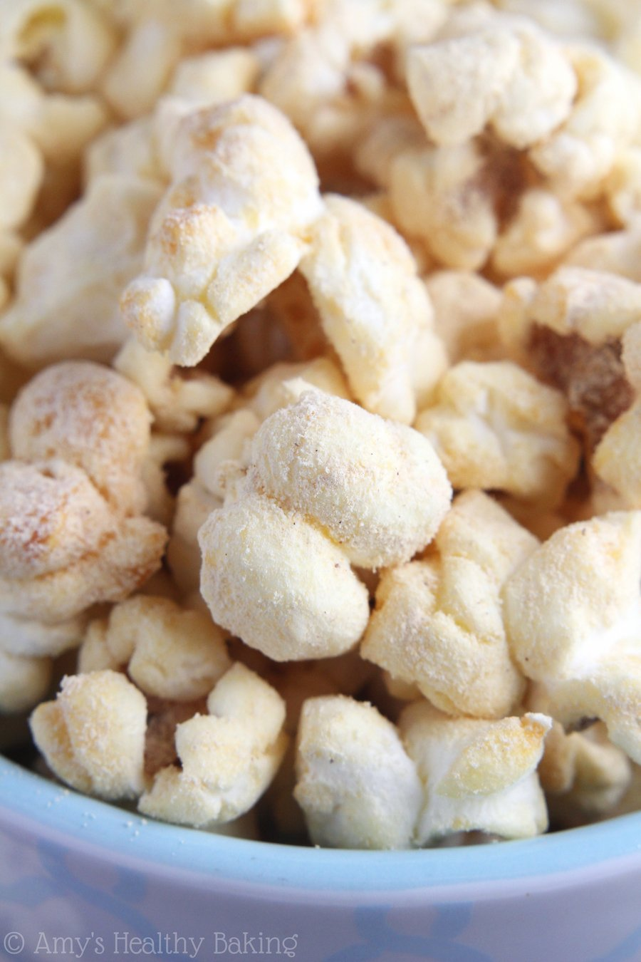 Skinny Peanut Butter Kettle Corn -- you only need 4 ingredients & a pot to make this easy treat at home! Just 120 calories & 4g of protein in each big serving!