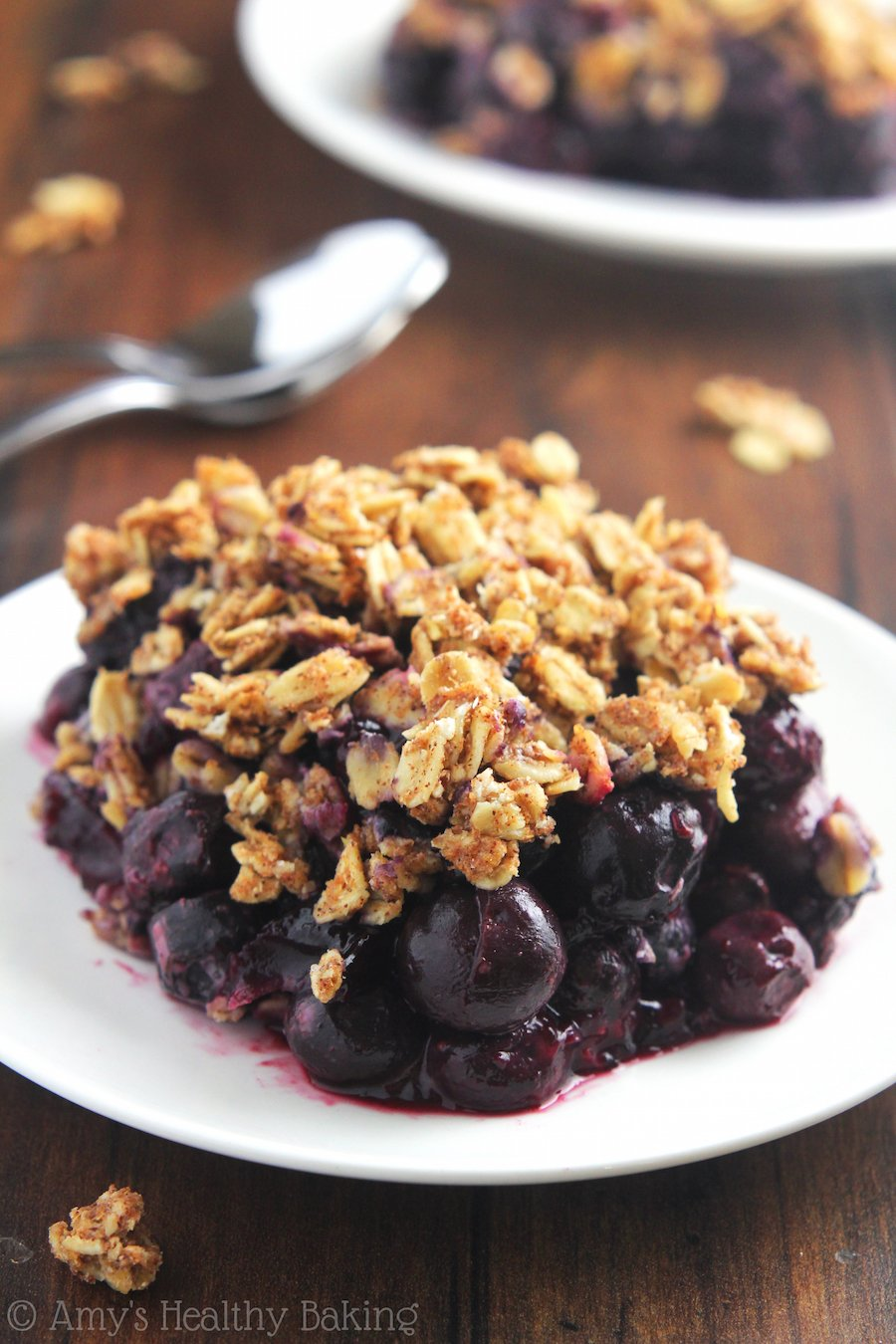 Clean-Eating Blueberry Almond Crumble -- this easy dessert is healthy enough for breakfast! It has a full serving of fruit & barely 120 calories!
