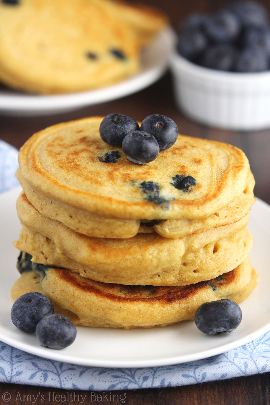 The Ultimate Healthy Blueberry Buttermilk Pancakes -- so light & fluffy! These are WAY better than any pancakes I've ever had! They don't taste healthy at all!
