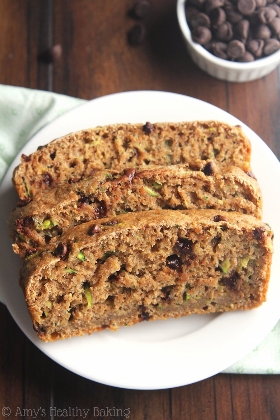 Whole Wheat Chocolate Chip Zucchini Bread -- this healthy, clean-eating recipe tastes as tender as cake! Packed with nearly 5g of protein!