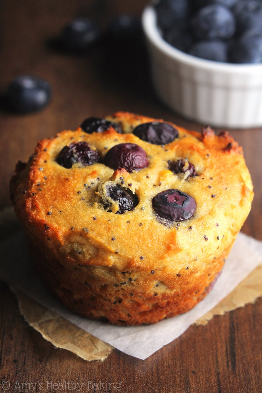 Blueberry Lemon Poppy Seed Protein Muffins -- a quick, easy & healthy breakfast treat! They're packed with 8g+ protein & practically taste like cupcakes!