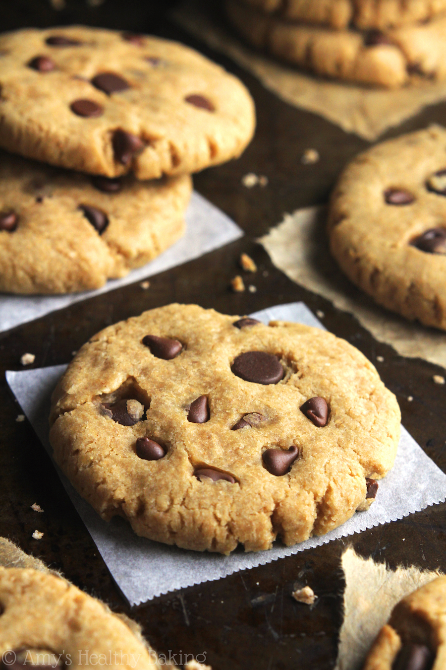 Clean-Eating Chocolate Chip Peanut Butter Cookies -- these skinny cookies don't taste healthy at all! You'll never need another peanut butter cookie recipe again!