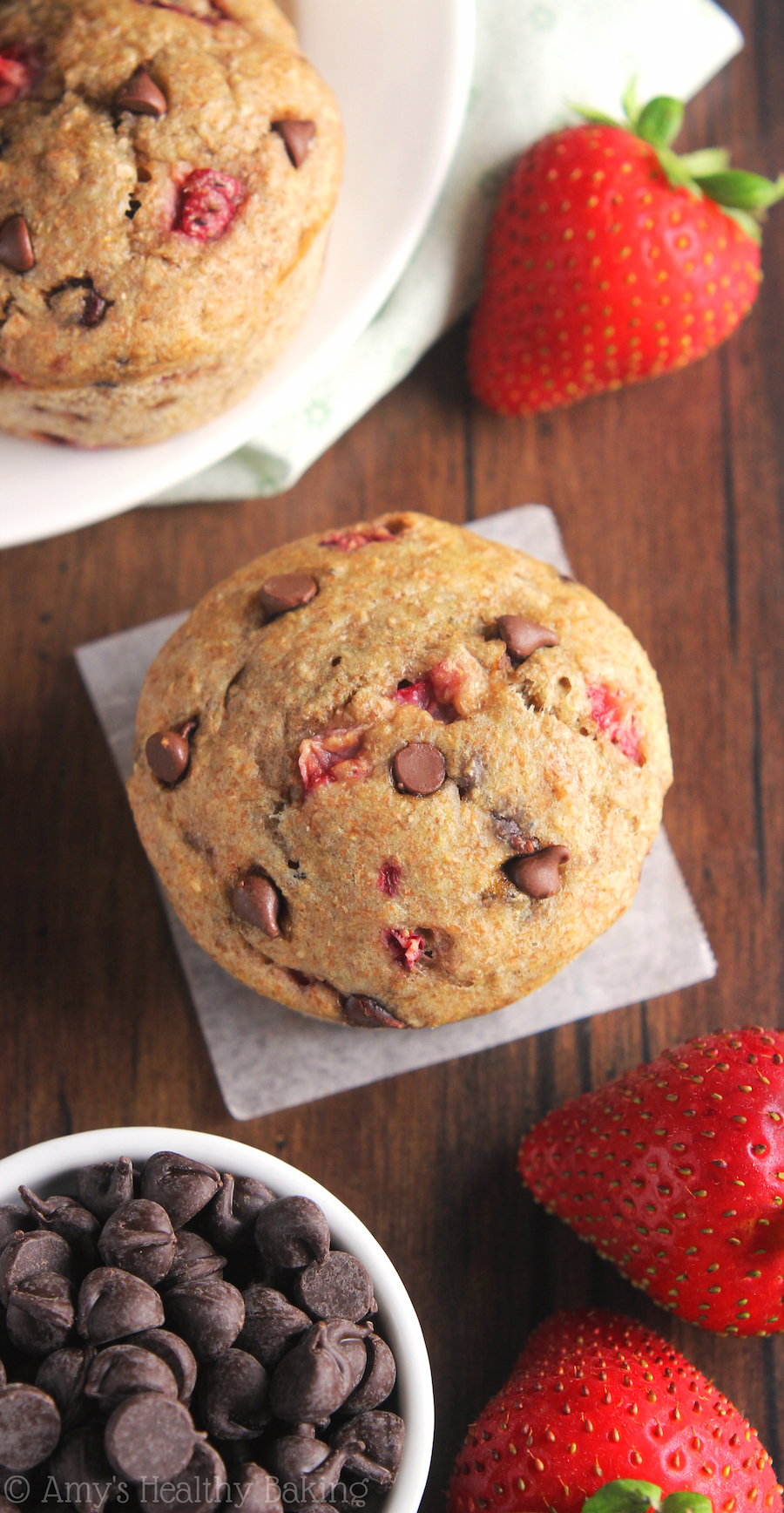 Clean-Eating Chocolate Chip Strawberry Banana Muffins -- this healthy recipe has the same texture cupcakes! Just 134 calories & packed with 3 superfoods!