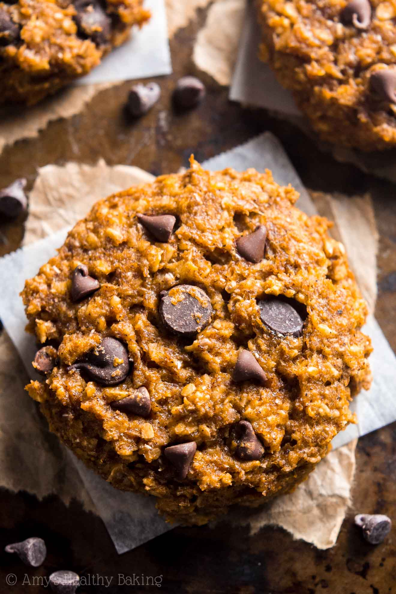 Clean-Eating Chewy Pumpkin Pie Chocolate Chip Oatmeal Cookies -- these skinny cookies don't taste healthy at all! You'll never need another pumpkin cookie recipe again!
