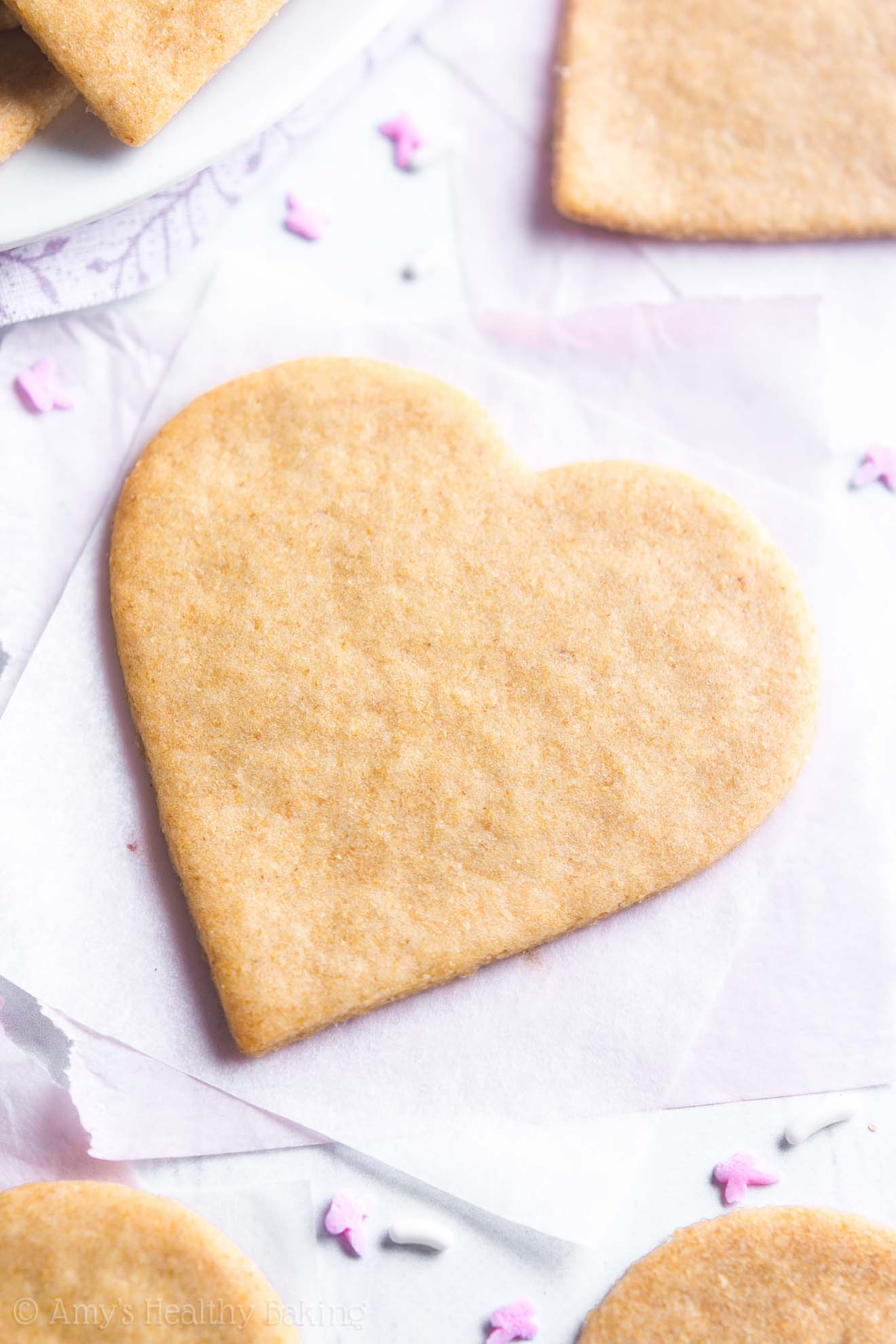 The ULTIMATE Healthy Soft Cut-Out Sugar Cookies cut into heart shapes