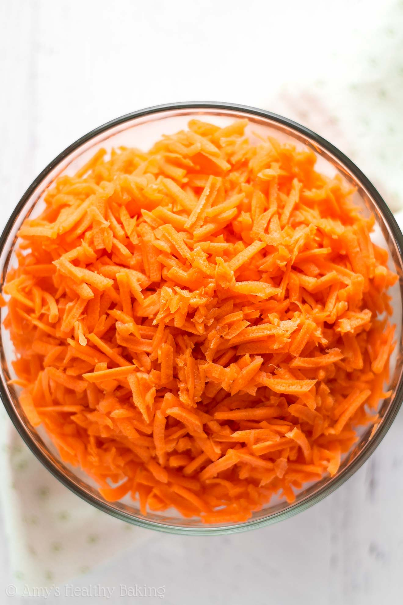 Freshly grated carrots, used to make the best healthy carrot cake