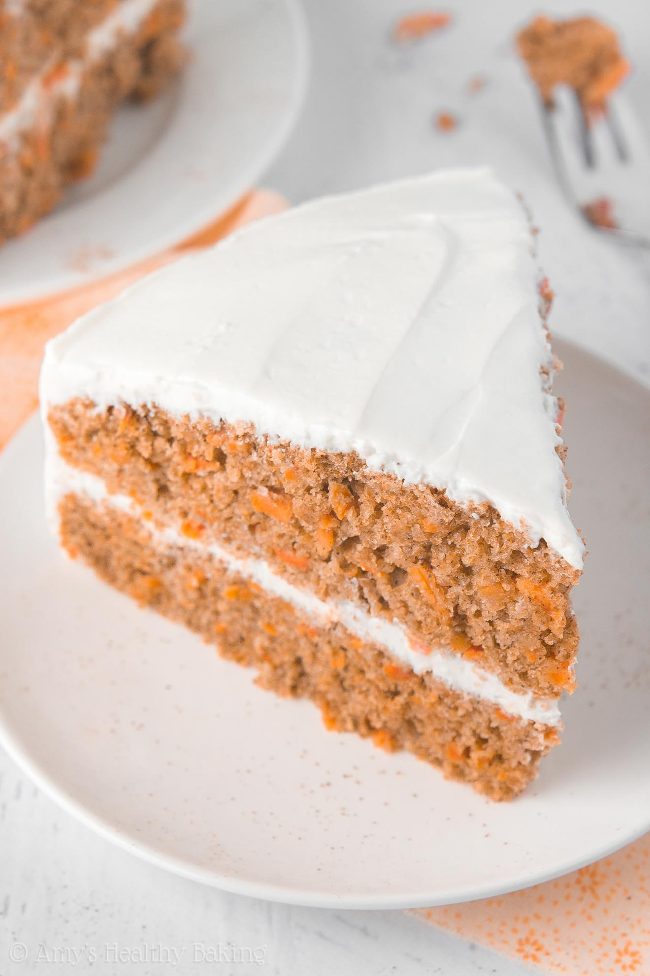 The BEST Healthy Carrot Cake, a two-layer cake with cream cheese frosting