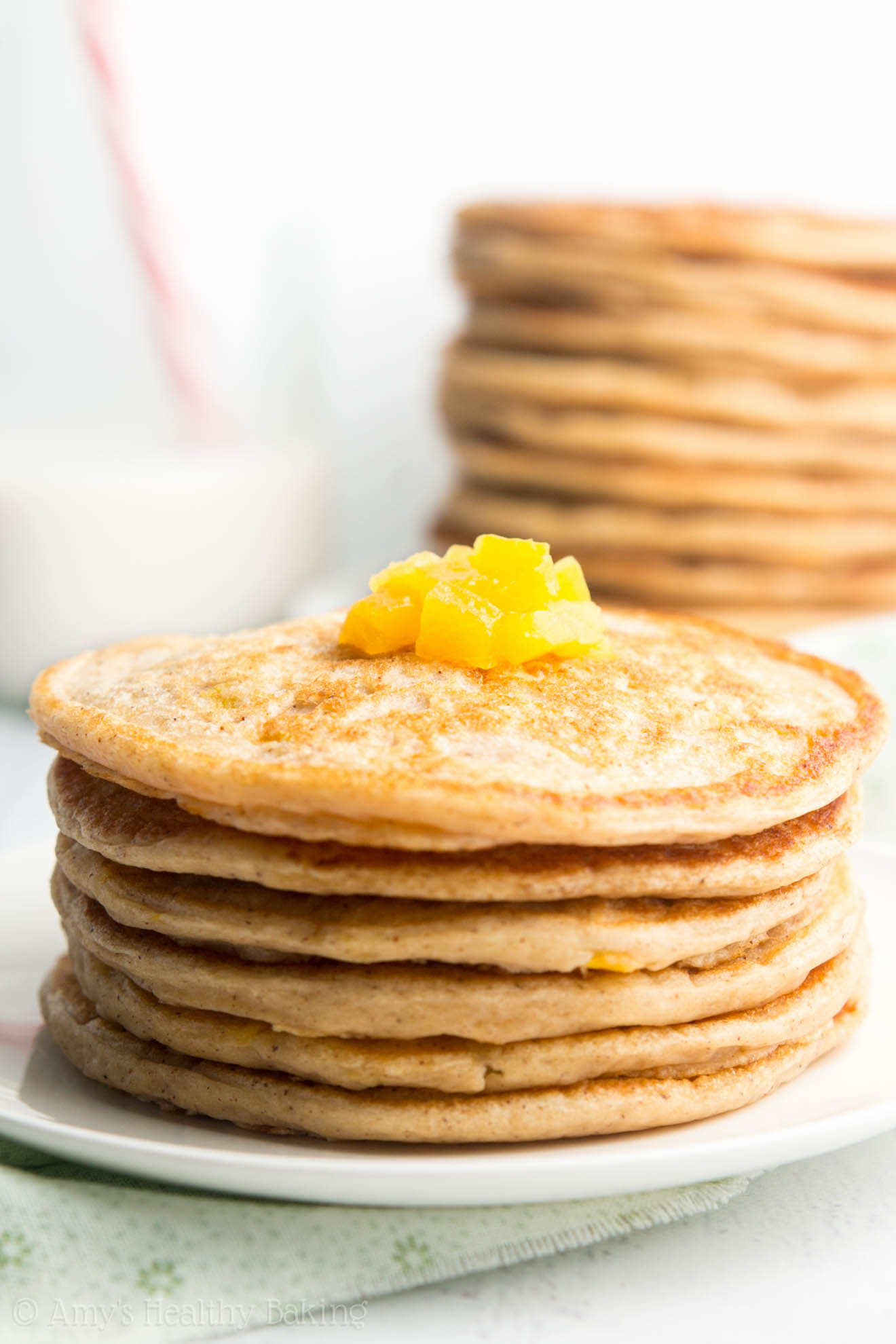 Healthy Peach Pie Pancakes -- so easy & packed with 8g+ of protein! My family loves this recipe! It's like eating dessert for breakfast!