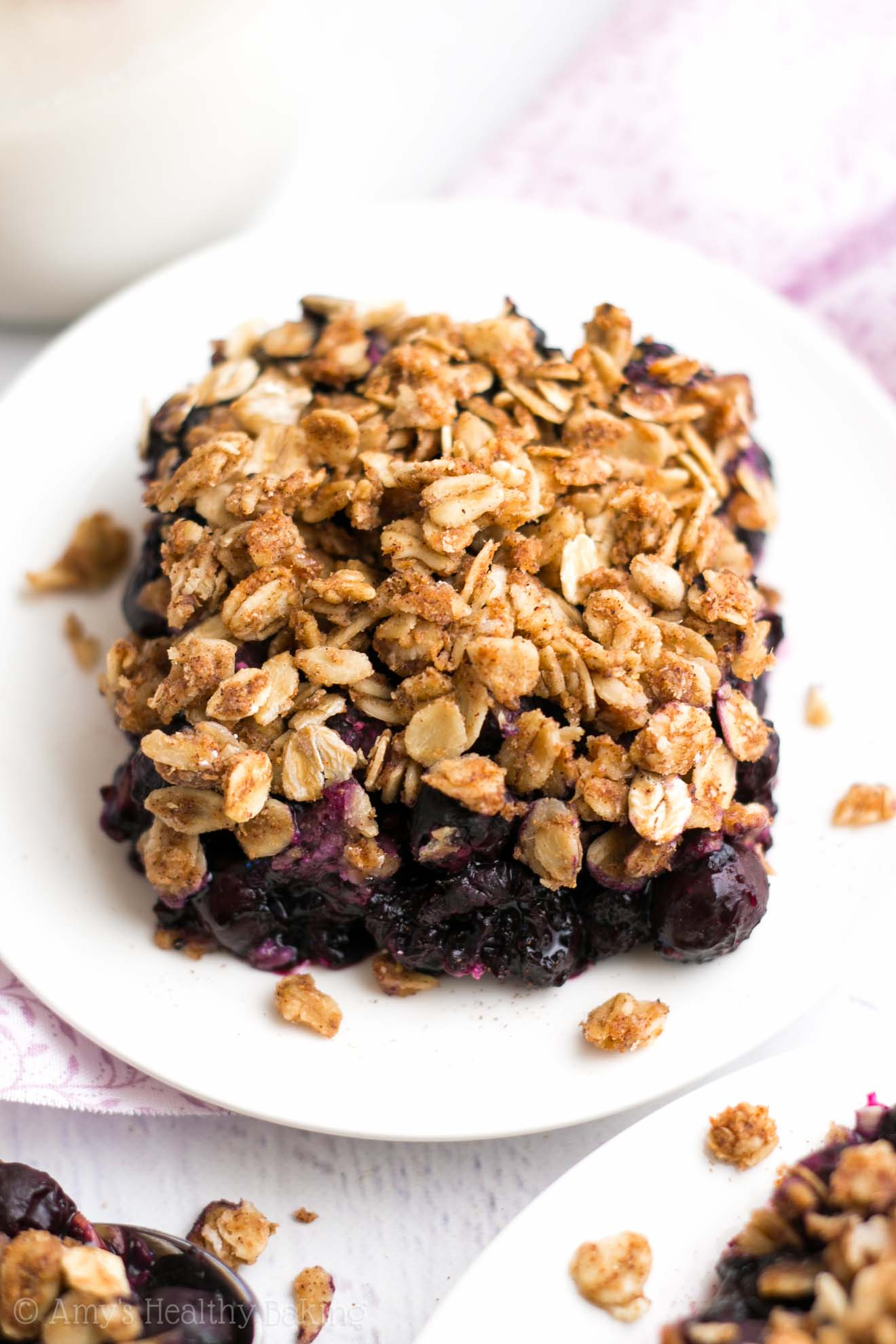 The Ultimate Healthy Blueberry Crumble -- this easy dessert is healthy enough for breakfast! It has a full serving of fruit & just 127 calories!