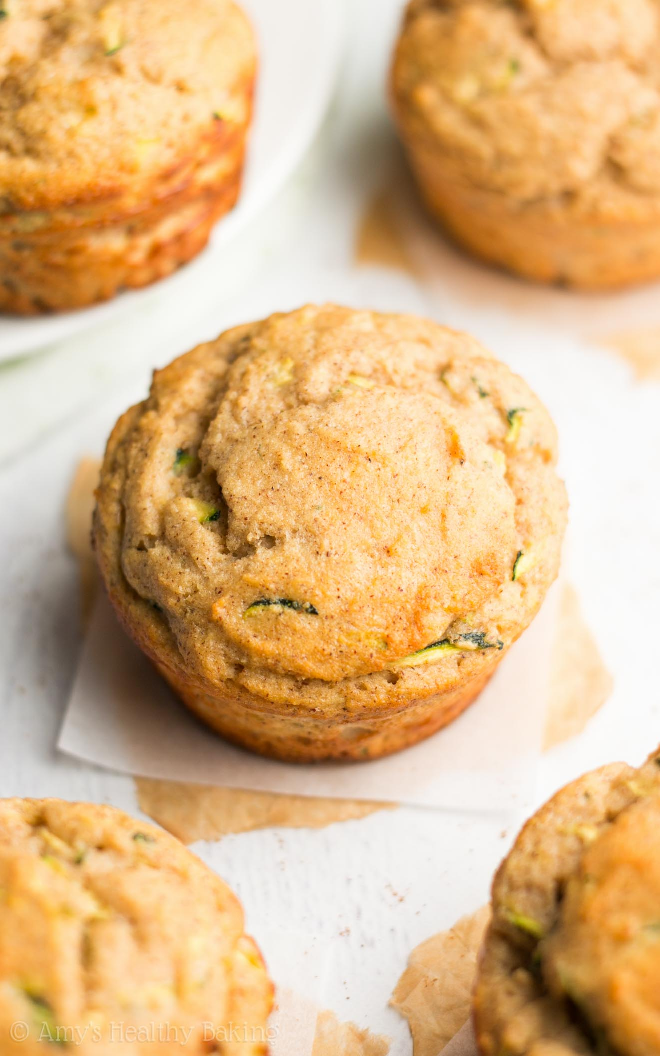 Zucchini Bread Protein Muffins -- a quick, easy & healthy breakfast treat! Just 112 calories & nearly 10g of protein!