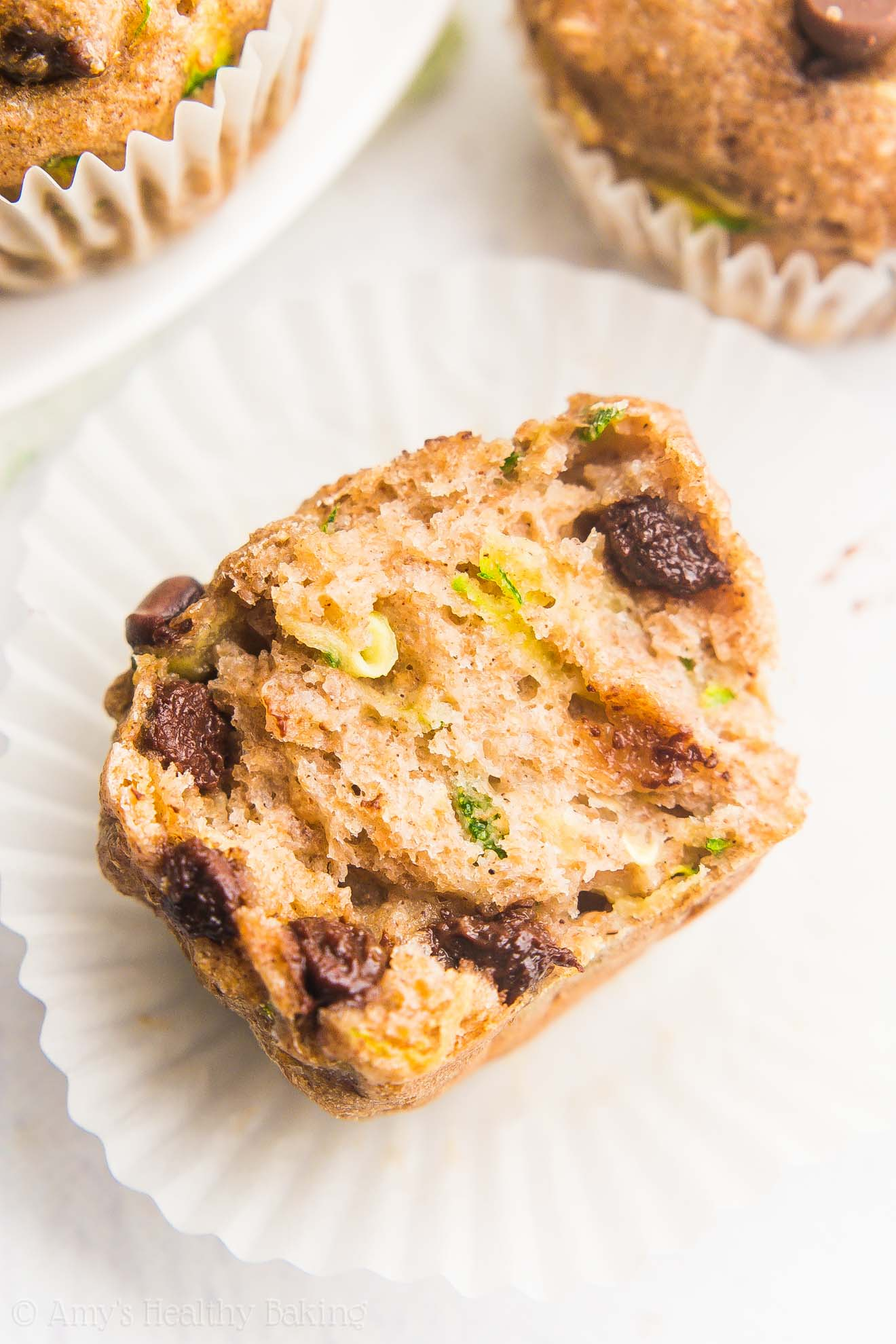 Healthy Chocolate Chip Zucchini Mini Muffins -- SO easy & good! Just 47 calories & like eating cupcakes for breakfast!