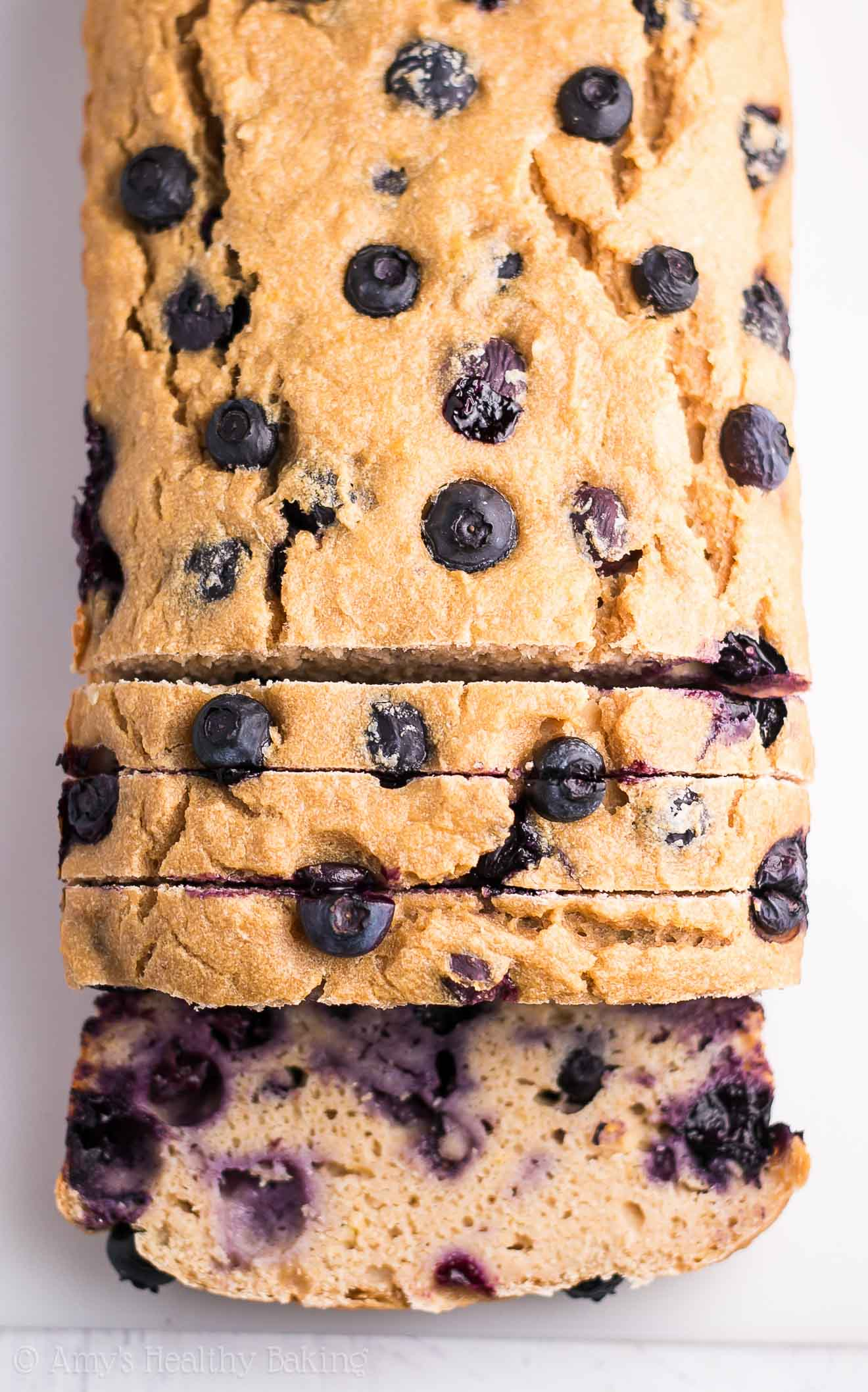 Healthy Greek Yogurt Blueberry Lemon Pound Cake -- just 133 calories with 6g+ of protein! This easy recipe is SO good & secretly healthy enough for breakfast!