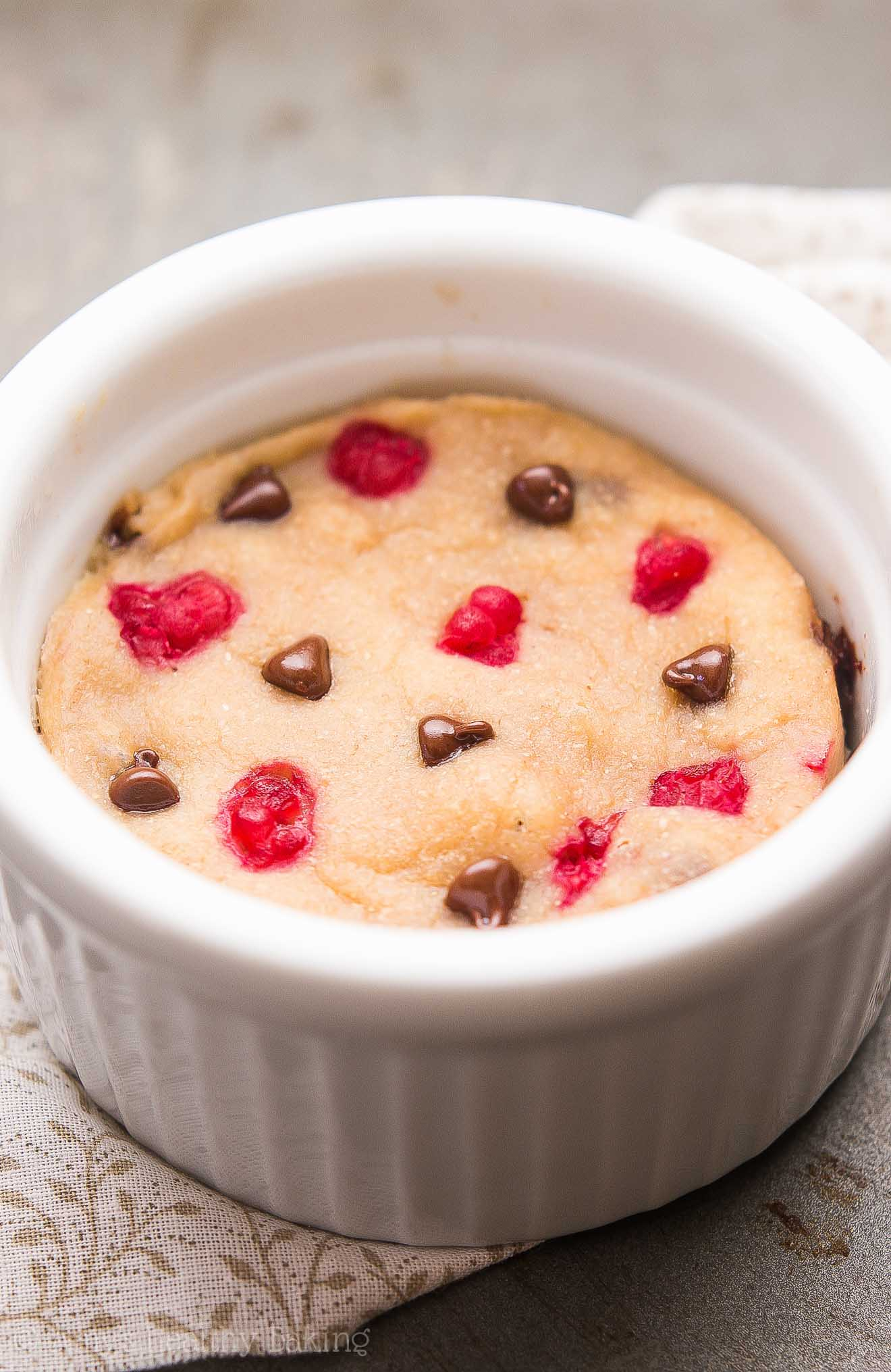 Skinny Single-Serving Raspberry Chocolate Chip Mug Cake -- an easy recipe that's practically healthy enough for breakfast! Just 129 calories with 5g+ of protein!