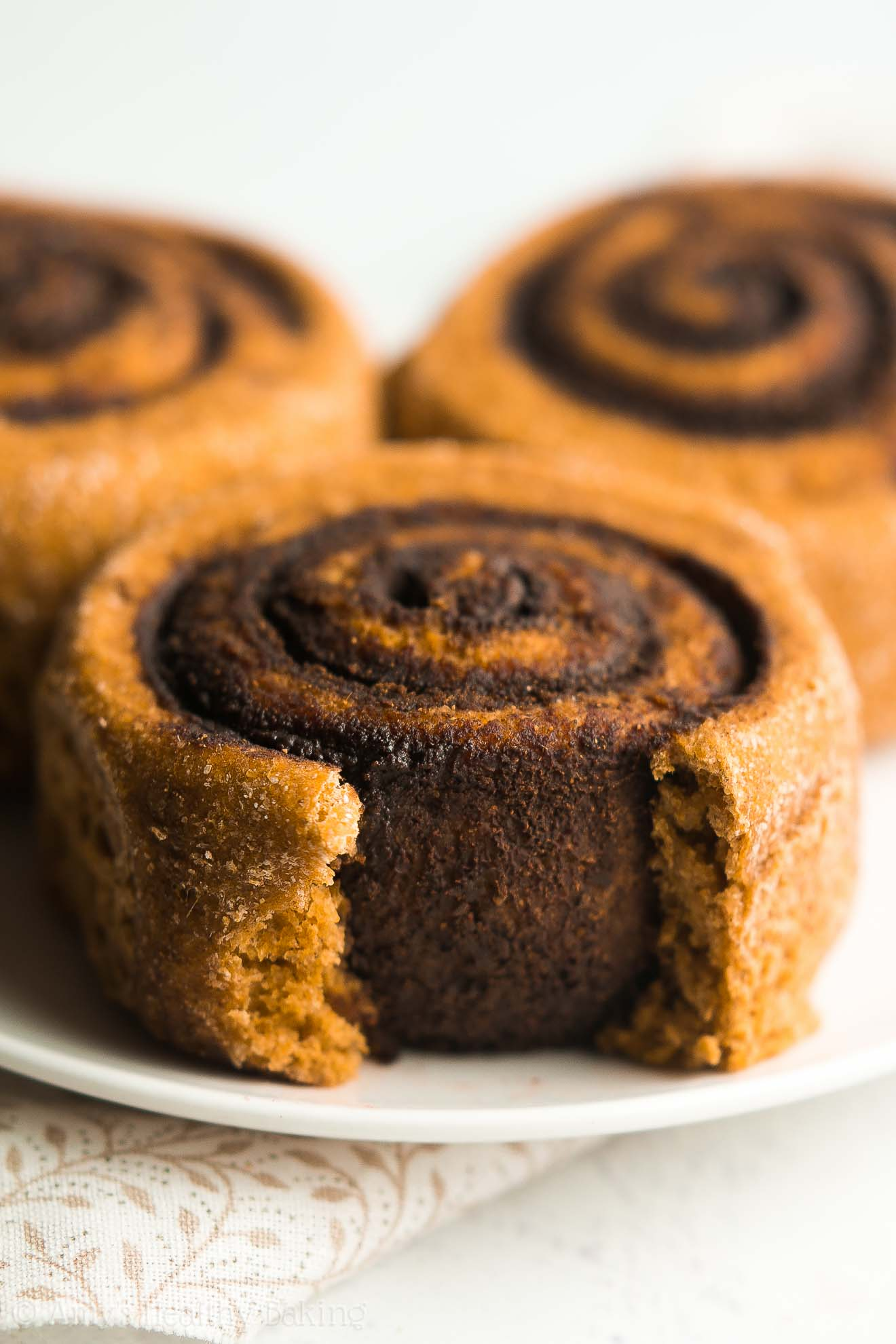 Healthy Chocolate Pumpkin Cinnamon Rolls -- just 113 calories! And that decadent chocolate filling is to DIE FOR!