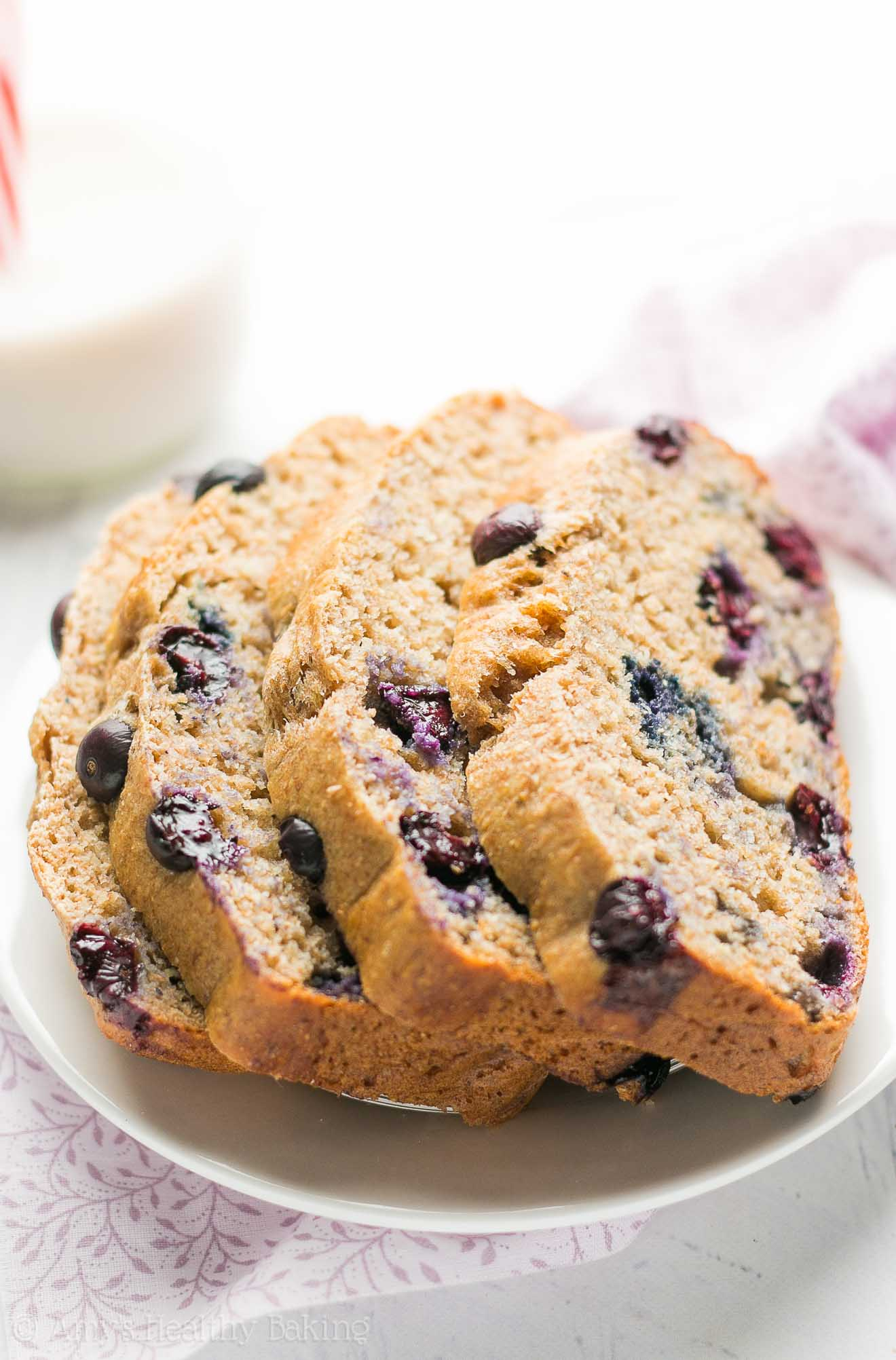 Skinny Blueberry Buttermilk Banana Bread - so easy, 110 calories & 4g+ of protein! A great healthy breakfast or snack!