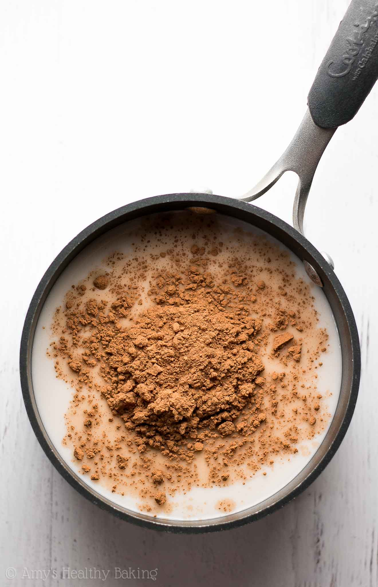 Make your coffee taste like a peppermint mocha with this healthy coffee creamer! It's SO easy to make & just 2 calories per tablespoon!