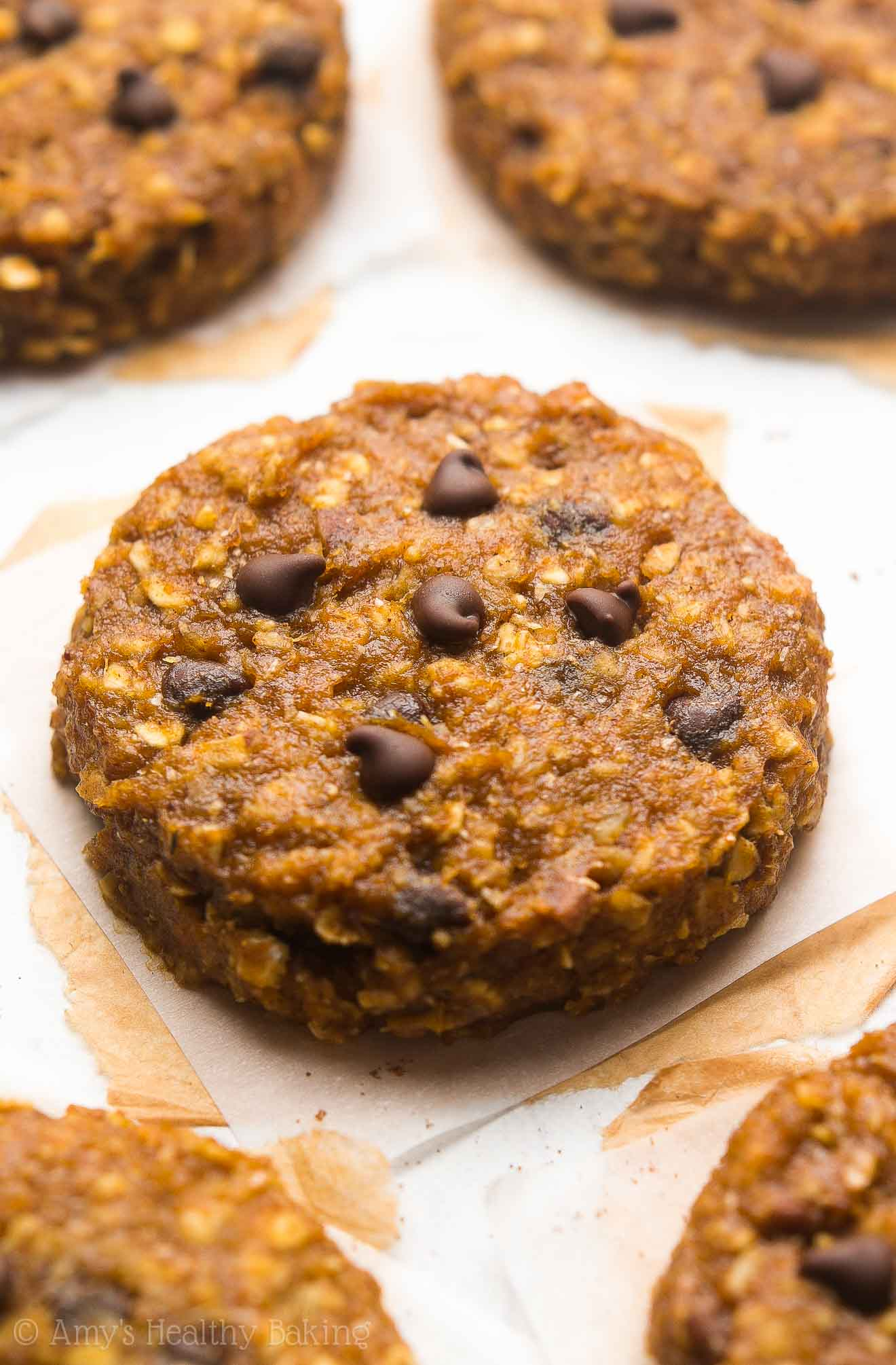 Healthy Pumpkin Cowboy Cookies -- only 100 calories & so easy! Oatmeal + pumpkin + chocolate chips = a match made in heaven!