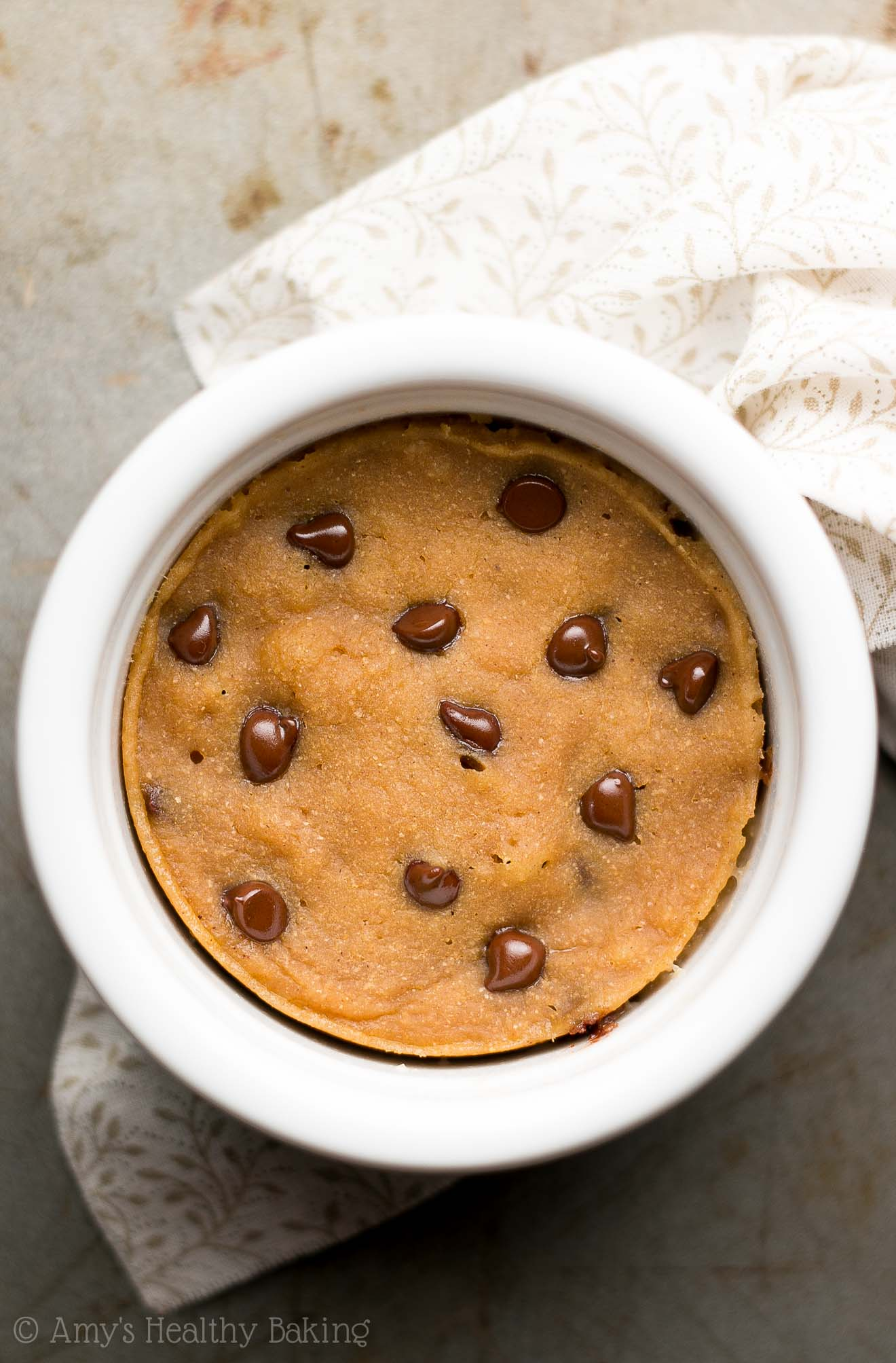 Skinny Single-Serving Chocolate Chip Gingerbread Mug Cake -- an easy recipe that's healthy enough for breakfast! Only 135 calories & 5g+ protein!