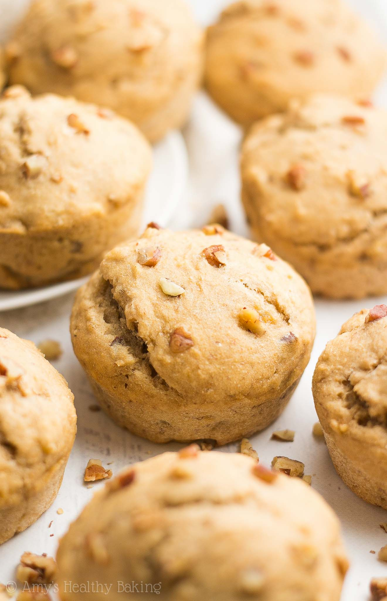 The Ultimate Healthy Banana Nut Muffins -- only 125 calories! No butter, refined flour or sugar, but they practically taste like cupcakes!