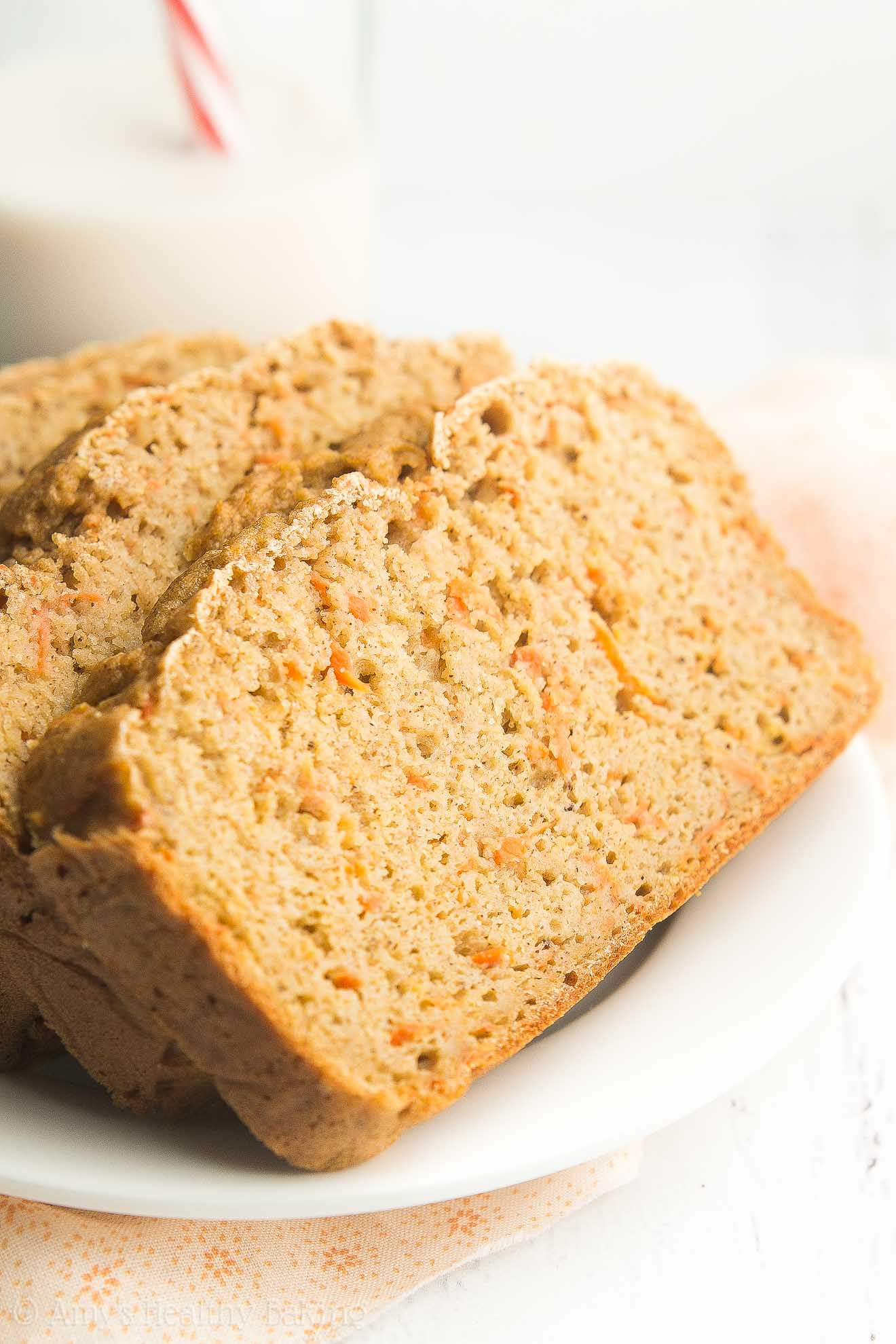 Healthy Greek Yogurt Carrot Cake Pound Cake -- sweet, cozy & only 134 calories! You NEED to try this easy recipe! It's the BEST pound cake I've ever had!