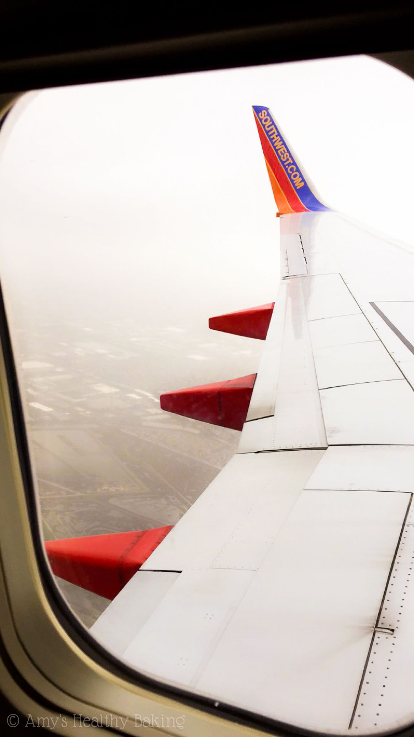 foggy view looking out of a Southwest Airlines window seat