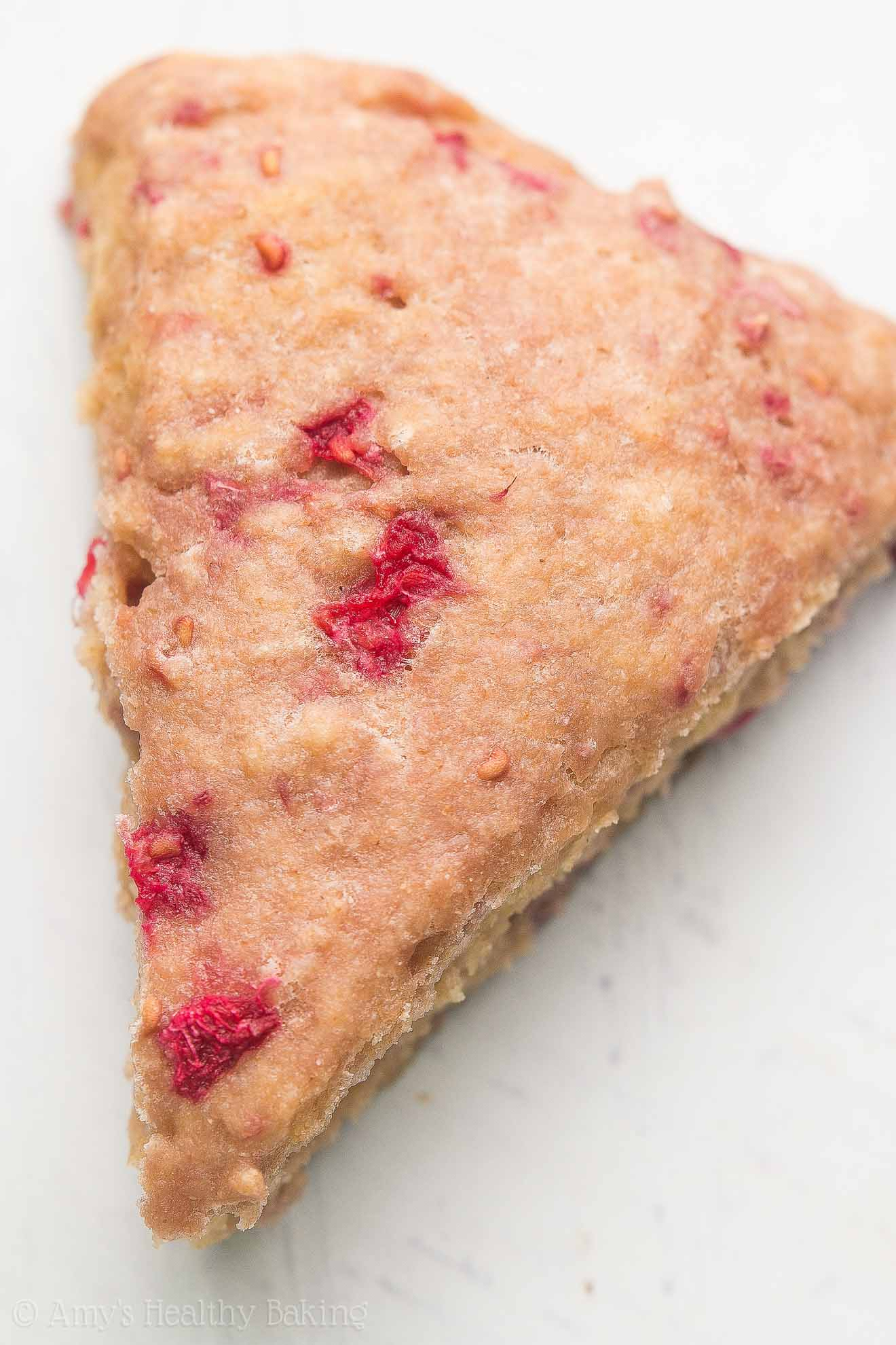 Healthy Raspberry Almond Scones -- an easy, one-bowl recipe with just 133 calories! Made guilt-free with Greek yogurt! My family absolutely LOVES these!!