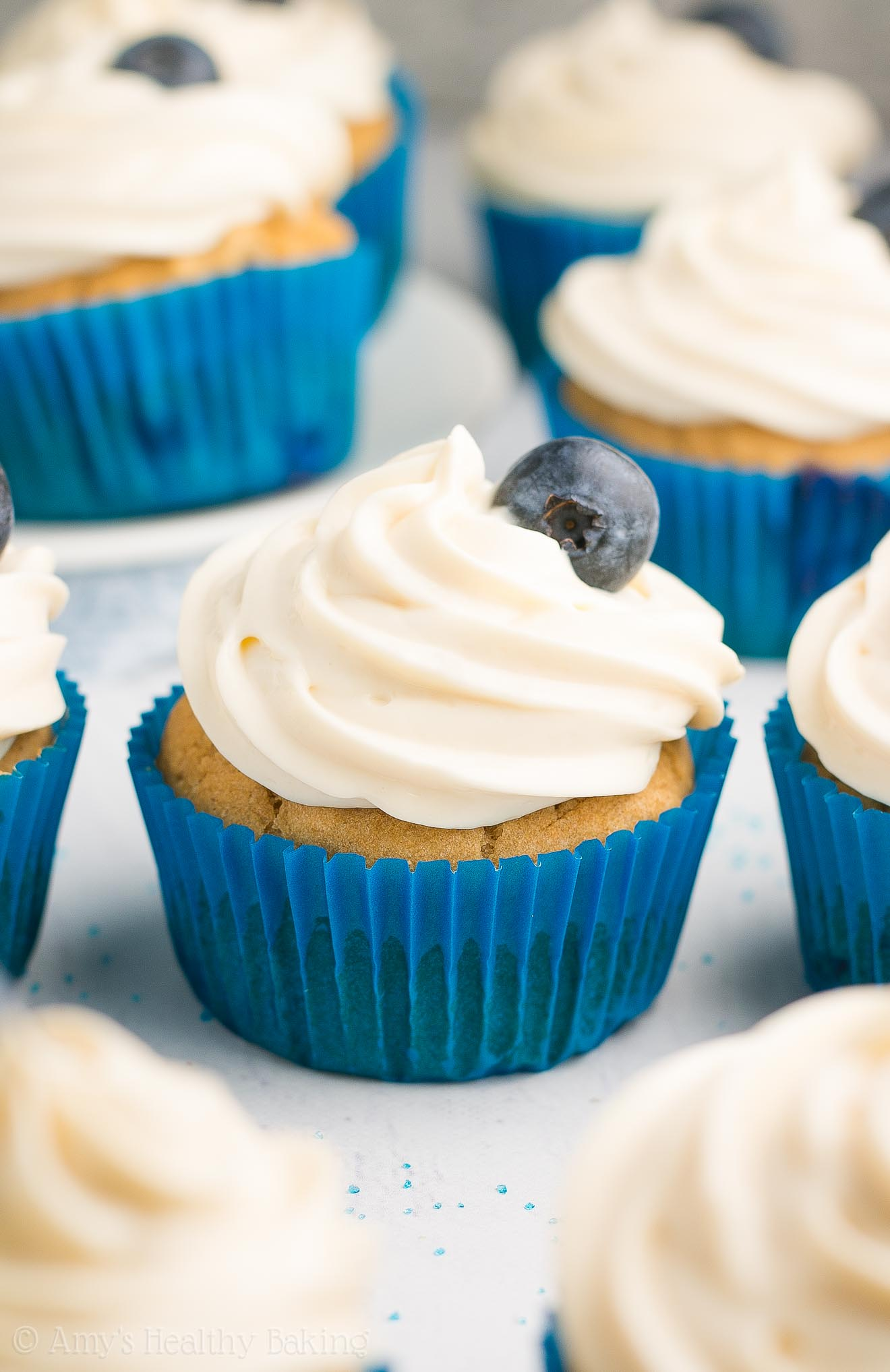 {HEALTHY!} Blueberry Cupcakes with Cream Cheese Frosting -- only 130 calories! They taste like they came from a fancy bakery, but this recipe is SO easy! Such a dream come true!