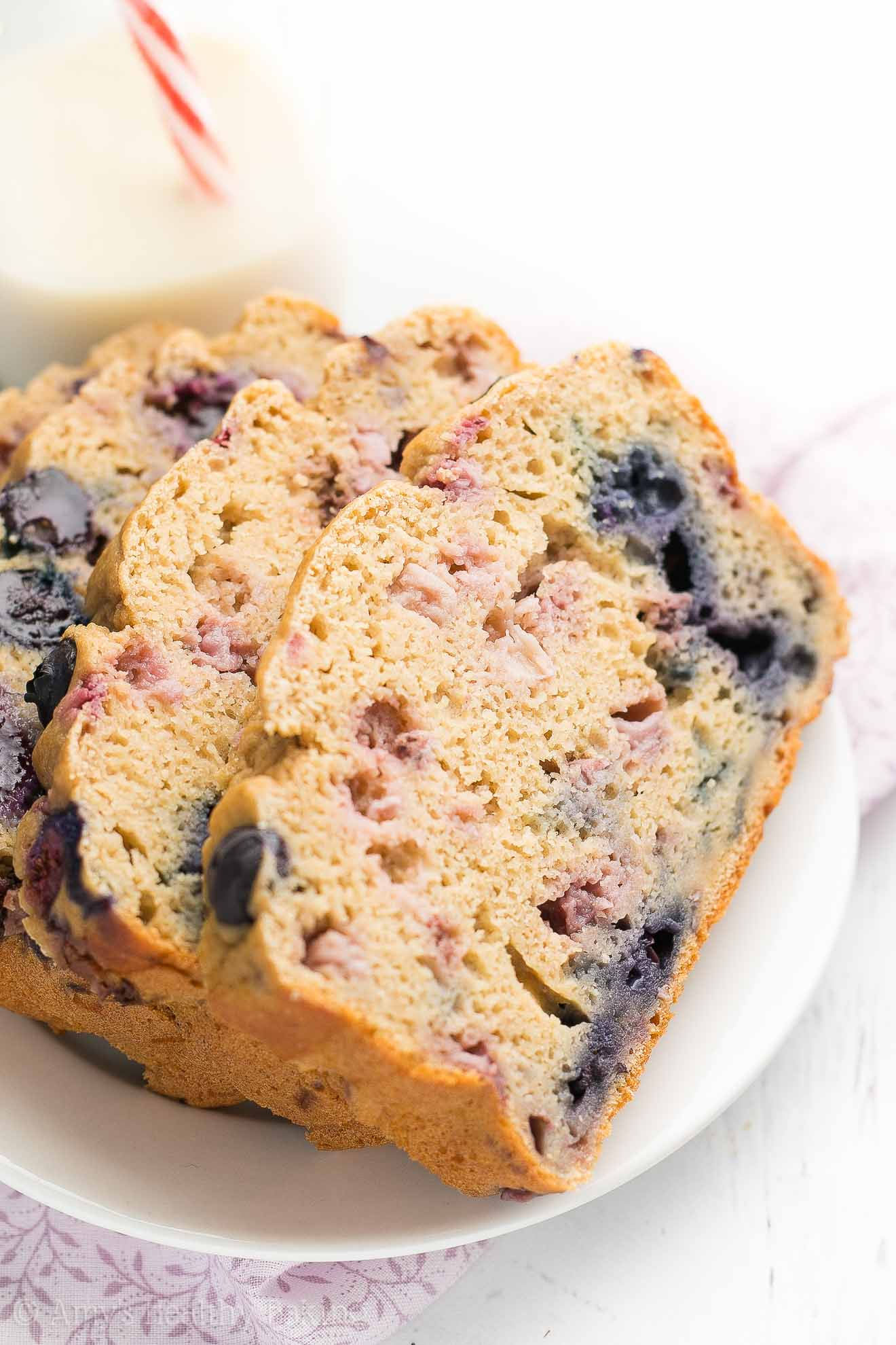 Greek Yogurt Strawberry Blueberry Pound Cake -- only 134 calories & it doesn't taste healthy at all! Sweet, buttery, tender perfection! You NEED to try this recipe -- it's incredible!