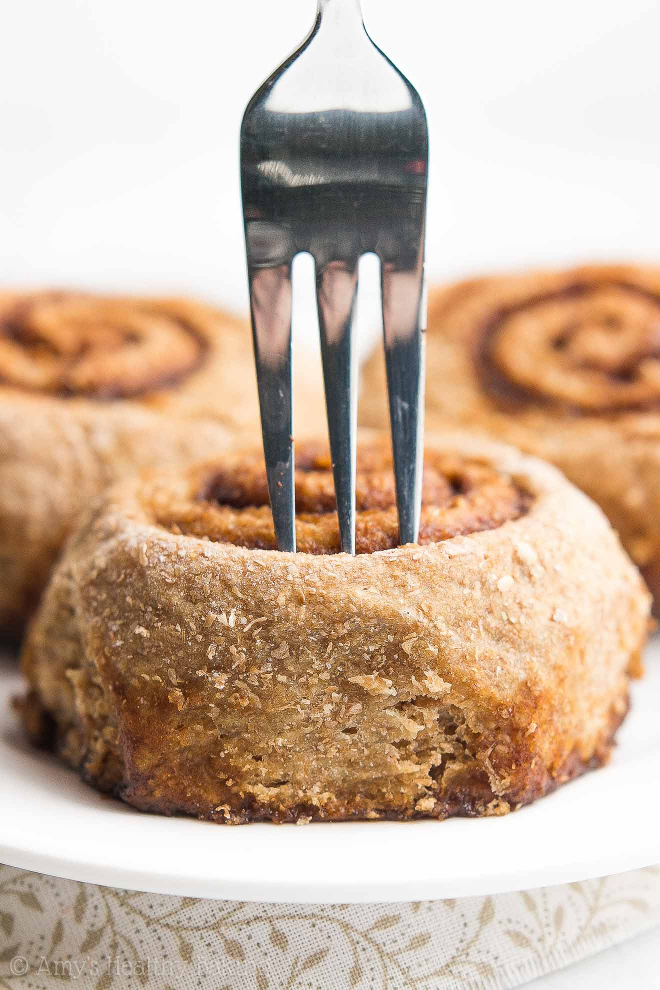 The ULTIMATE Healthy Cinnamon Rolls -- only 112 calories! Sweet, fluffy, cozy, gooey... Everything a perfect cinnamon roll should be! You'll never use another cinnamon roll recipe again!