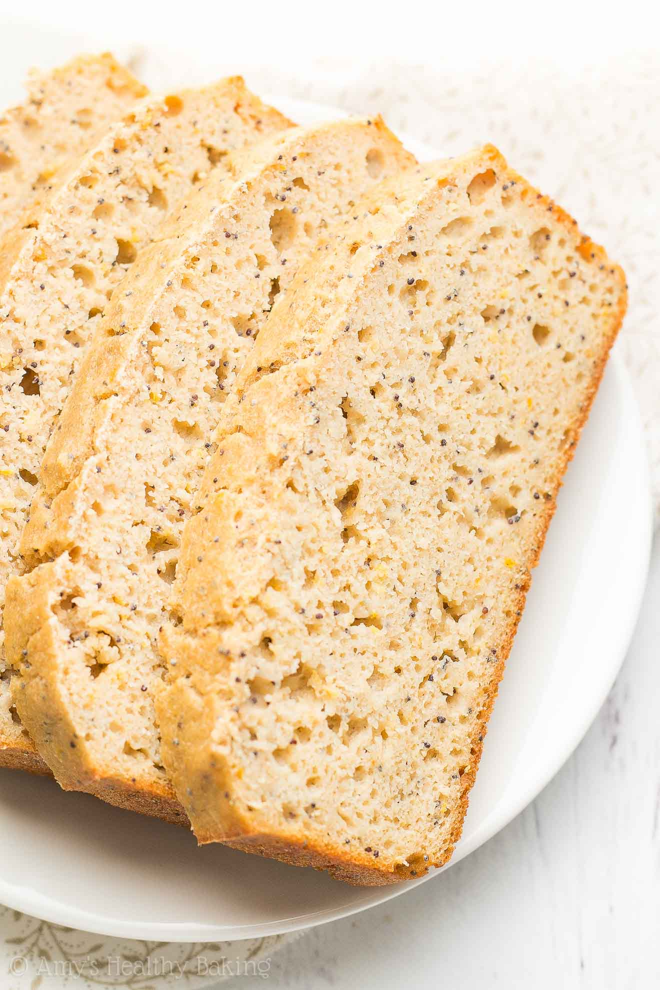 {HEALTHY!} Greek Yogurt Lemon Poppy Seed Pound Cake -- only 127 calories! Sweet, tender & bursting with bright citrus flavor! The BEST lemon cake I've ever had!